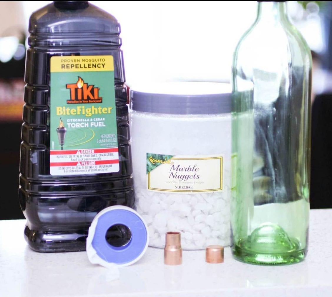 wine bottle crafts diy ideas tiki torches | tiki wine bottle | DIY tiki torch | wine bottle craft | reuse wine bottle | patio decor | recycle wine bottle | Never Skip Brunch by Cara newhart