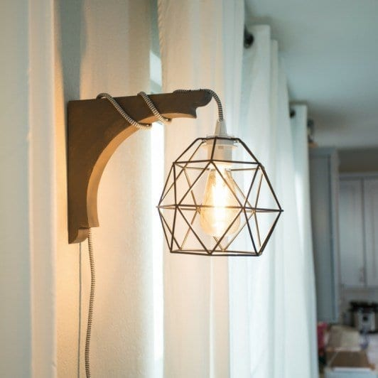 This diy corbel light does not require a drill. You can build this industrial diy corbel light sconce in under 30 minutes.| never skip brunch by cara newhart #decor #home #lighting