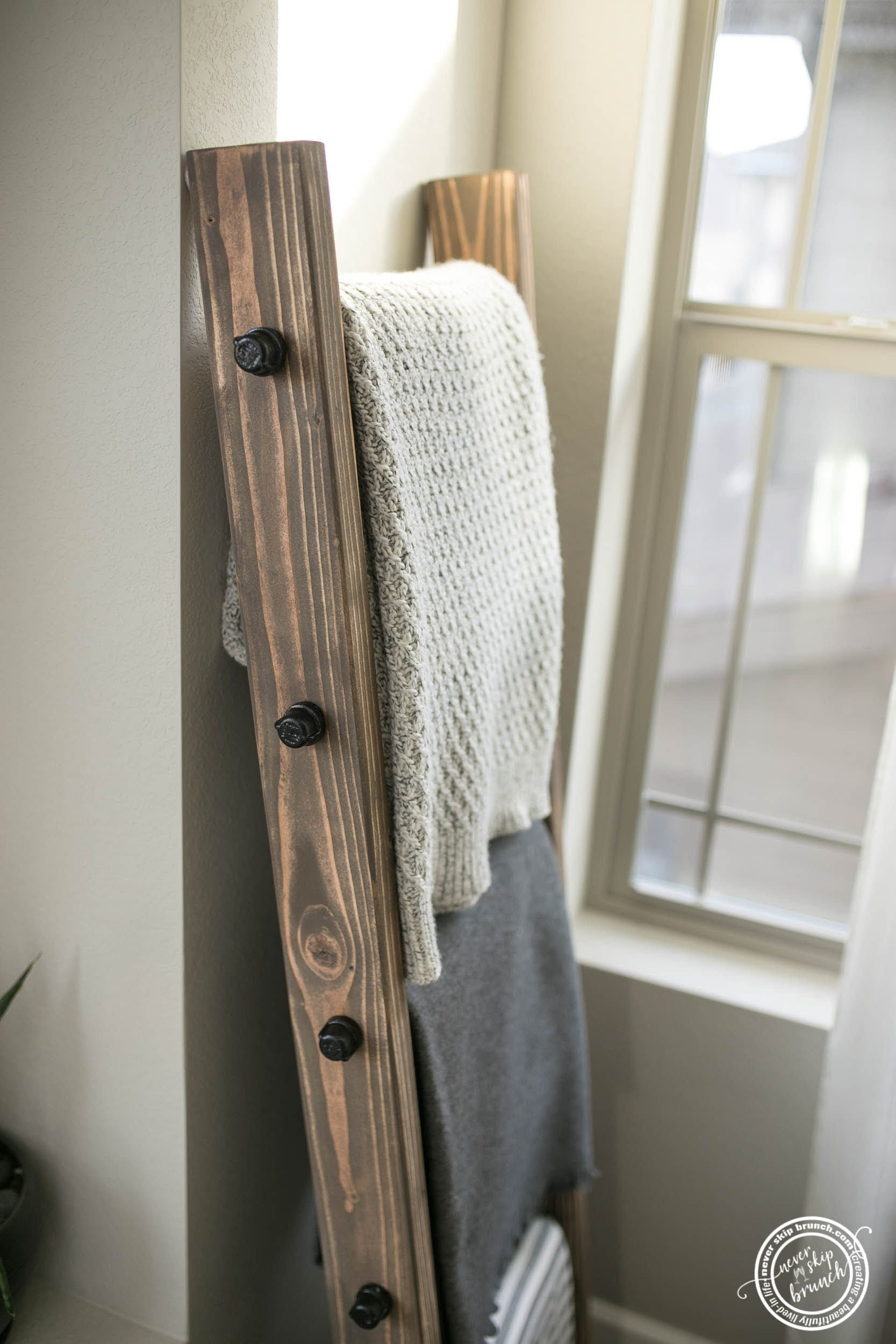 how to make a diy blanket ladder, a tutorial featured by top interior design blogger, Never Skip Brunch
