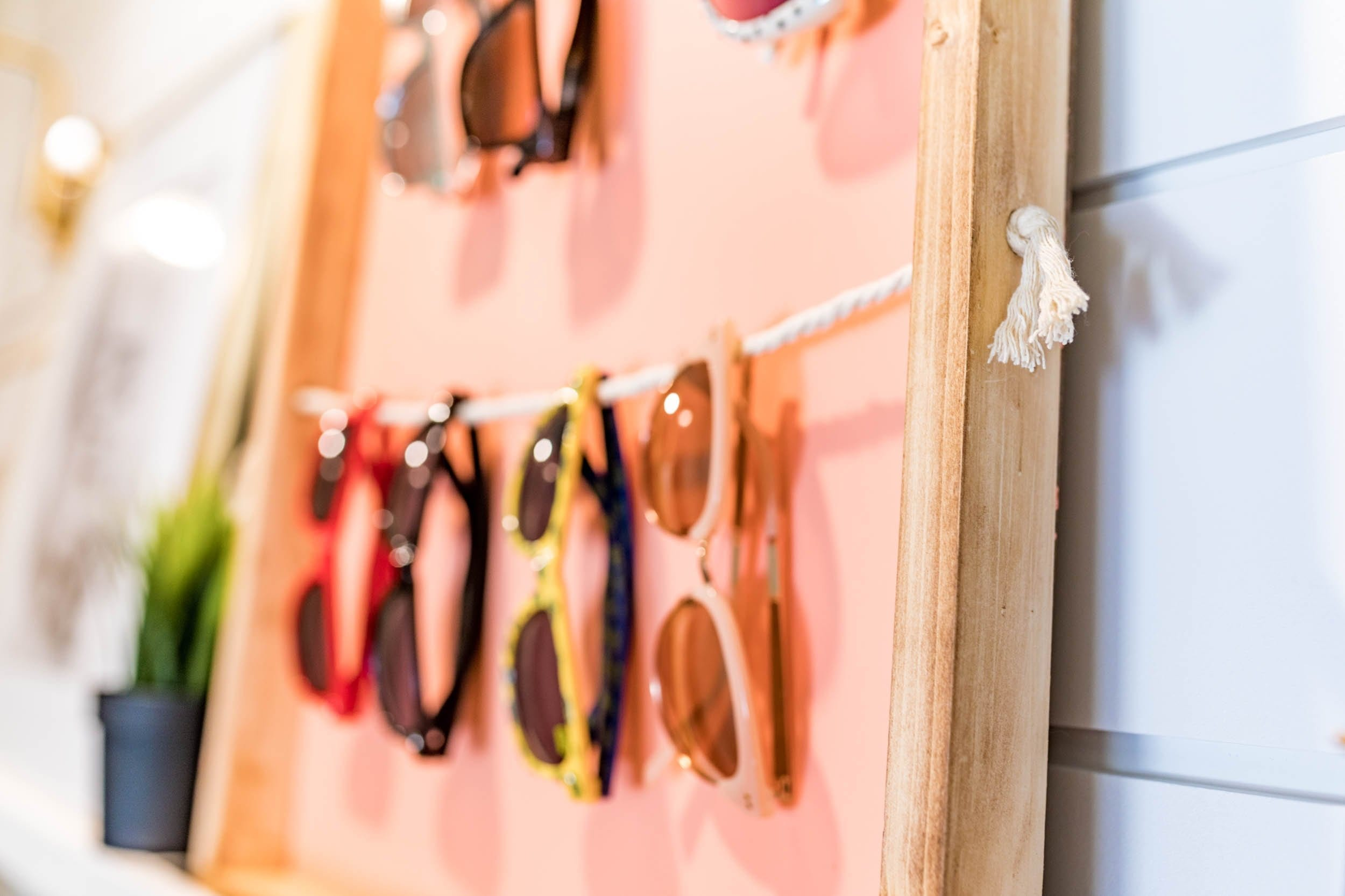 THIS IS GENIUS!! sunglasses holder diy | sunglasses holder diy display | sunglasses holder wall | sunglasses holder wall storage ideas | diy sunglass display | diy sunglass holder | home decor | DIY Home decor ideas | Never Skip Brunch by Cara Newhart | #decor #diy #summer #neverskipbrunch