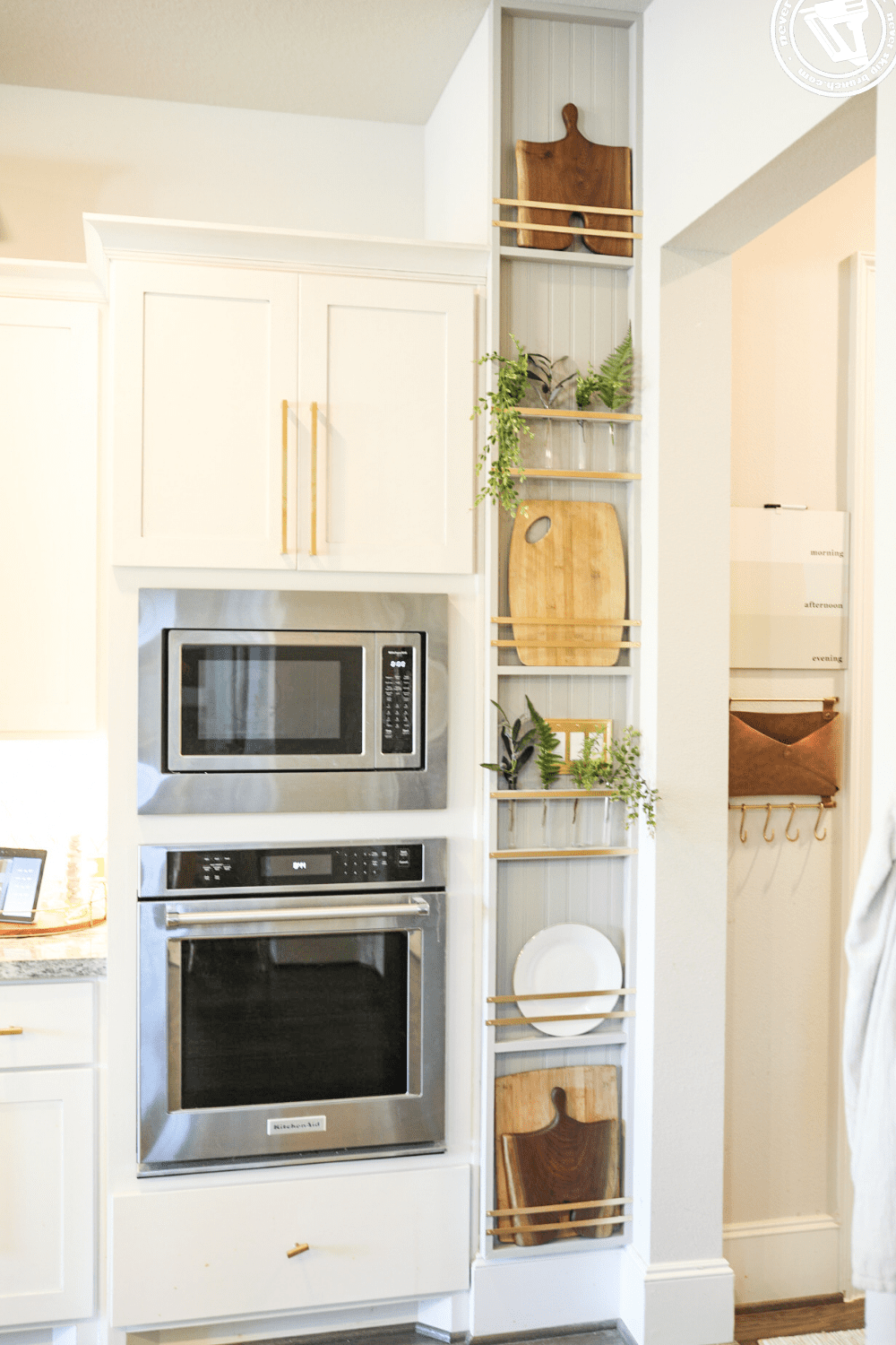 DIY Plant Wall + Kitchen Plate Rack featured by top US DIY blogger, Never Skip Brunch