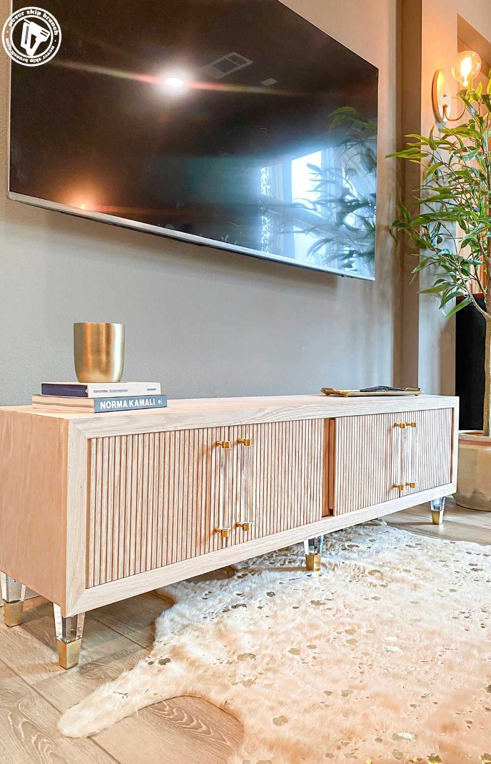 diy media console with kitchen cabinets featured by top US home DIY blogger, Never Skip Brunch